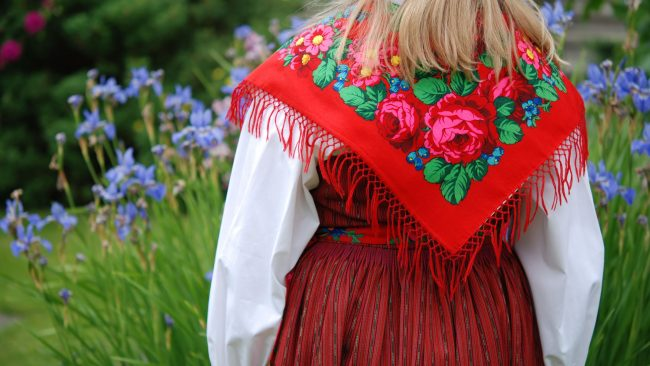Traditional dress of the Midsommar party in Sweden
