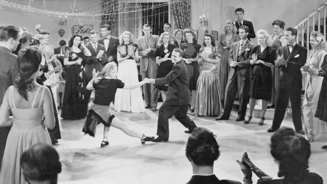 Young people dancing during the thirties, the era of swing