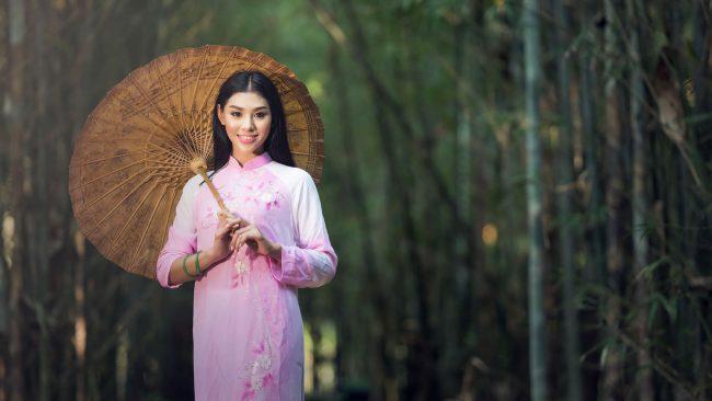 Chinese woman in long sleeve qipao
