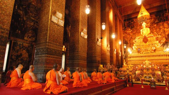 Buddhist monks in the Temple of the Reclining Buddha (Bangkok, Thailand)