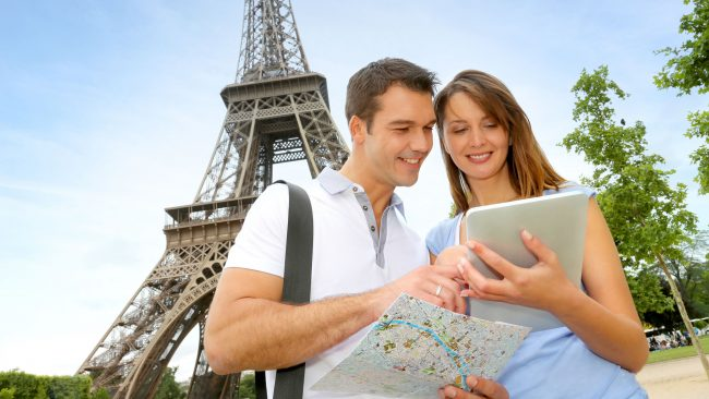 Tourists using a digital travel guide