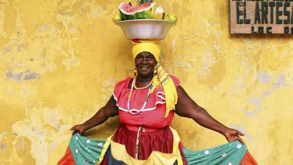 Traditional palenquera costume with fresh fruit basin