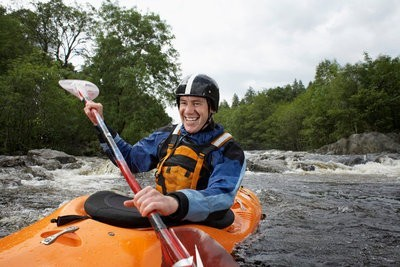Sportsman kayaking with the necessary equipment